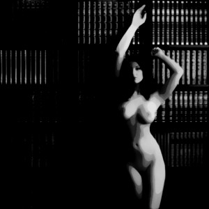 Me nude by a bookcase