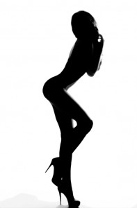 A naked woman poses in profile.